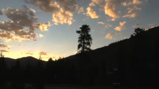 Yellow Sky and Colorado Mountain Silhouettes