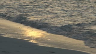 Yellow Sun Reflected in Ocean Waves