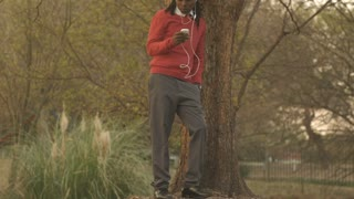 young African American man using cell phone for video calling