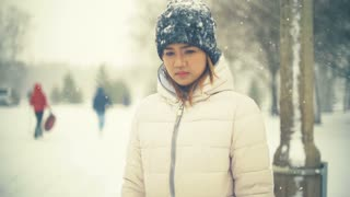 Young Asian Woman in winter park slowmotion