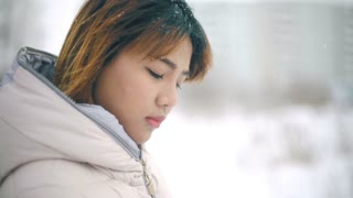 Young Asian Woman winter portrait slowmotion