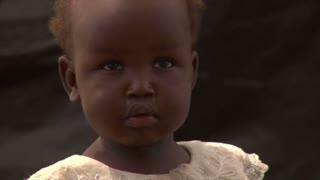 Young girl staring into camera