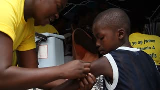 Young Haitian Boy Receives Vaccination Shot