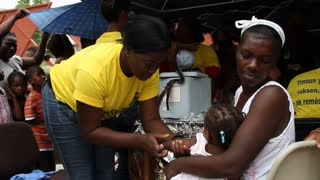 Young Haitian Child  Receives Vaccine Shot