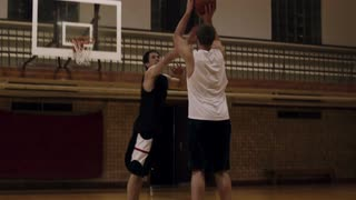 Young Male Making Three-Point Basketball Shot 2