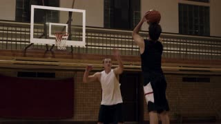 Young Male Making Three-Point Basketball Shot