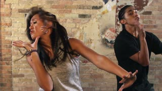 Young Man and Woman Hip Hop Dancing Together in Slow Motion