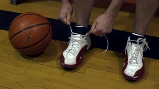 Young Man Tying Basketball Shoes