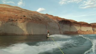 Young Man Wake Boarding In Lake Powell Utah