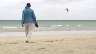 Young man walking on the beach, slow motion shot at240fps