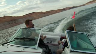 Young People Drive Ski Boat And Turns Sharply