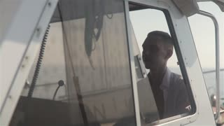 Young Skipper Driving Sailboat