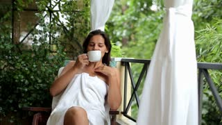 Young woman drinking coffee in the morninig, outdoors