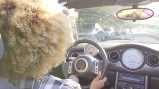 Young Woman Driving A Cabriolet.