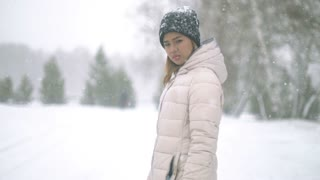 Young Woman during snow storm 4k UHD (3840x2160)
