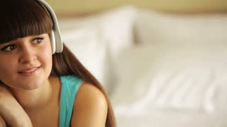 Young woman listening music and laughing