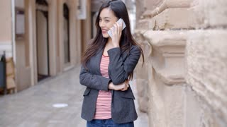 Young woman listening to a call on her mobile