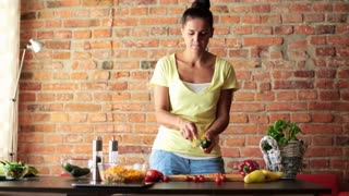 Young woman peel fresh cucumber
