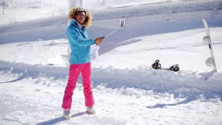 Young woman using a selfie stick