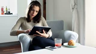 Young woman with tablet computer at home