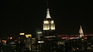 Zoom from Empire State Building to Busy Night Skyline