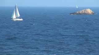 Zoom from Sailboat Sailing in Ocean in Spain