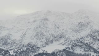 Zoom From Snowy Winter Mountains