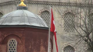 Zoom From Turkish Flag by Mosque Domes