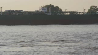 Zoom In On Cargo Ship Floating By On Mississippi River, New Orleans