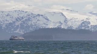 Zoom Out Alaskan Ferry Off Coast