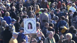 Zoom Out From Raunchy Protest Sign