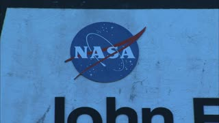 Zoom Out NASA Logo to Kennedy Center Sign