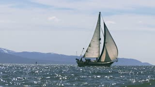 Zoom Out Sailing Ship Off Beach Coast