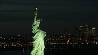 Zoom to Statue of Liberty Torch and Face at Dusk