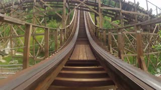 Zooming Along Wooden Roller Coaster Track