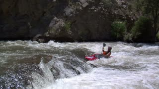 Zooming In On Man Paddling White-water Kayak Slow-motion Flipping Over