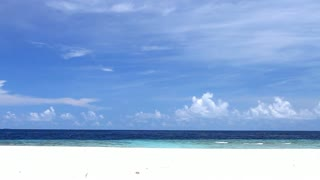 A View on Exotic Empty Beach With Sand and Ocean