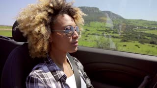 A Young Black Woman Driving