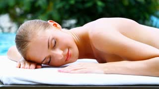 Adorable woman lying on spa bed