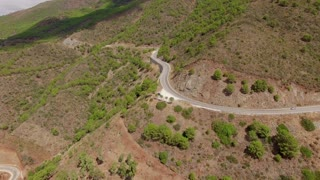 Aerial. A View From Flying Drone to Curvy Road