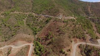 Aerial. Flight Over Curvy Road in Mountains
