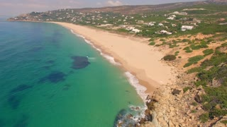 Aerial View from Flying Drone Over Beach and Sea