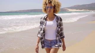 Afro-American Woman Walks Beach Along