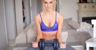 Athletic young woman working out at home