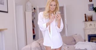 Attractive blond woman reading an sms