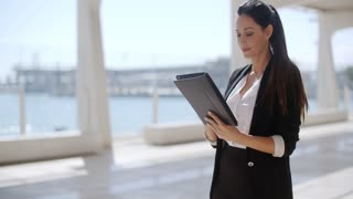 Attractive businesswoman working on a tablet