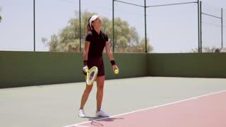 Attractive female tennis player wearing black