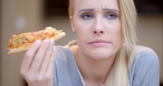 Attractive woman eating homemade pizza