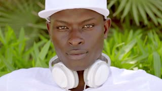 Attractive young African man with headphones
