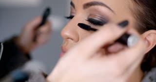 Beautician applying mascara